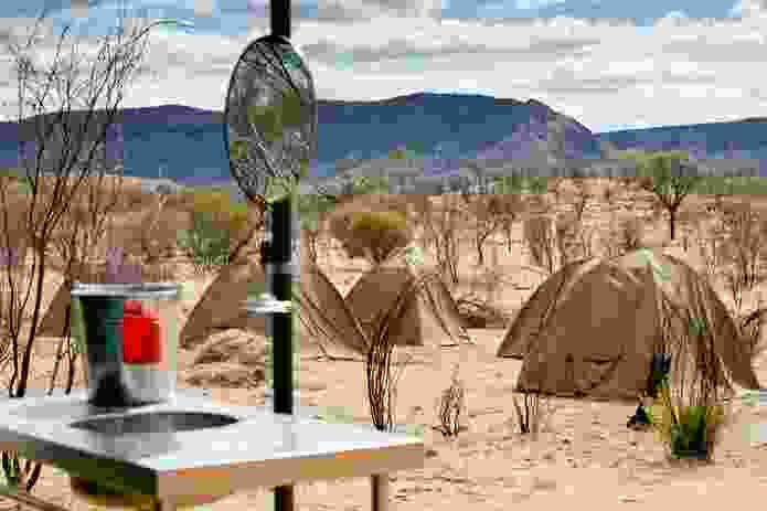 The muted green of trekkers' tents was inspired by the colours of spinifex and mallee.