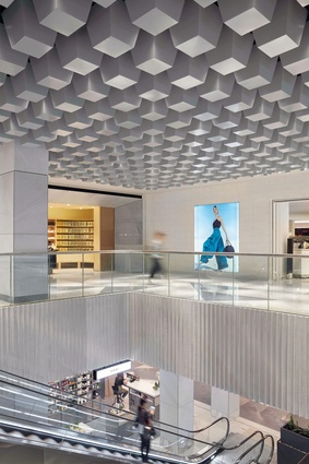 A geometric cast concrete coffered ceiling makes reference to the design language of the nearby National Gallery of Australia.