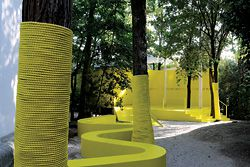 Approach to the Australian Pavilion, now painted bright yellow, with extended ramps and rope-wrapped trees. Image:Claudio Franzini