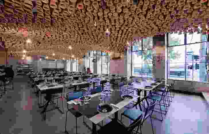 A beguiling ceiling installation made from terracotta pots hangs inside the fitout for Gazi in Melbourne.