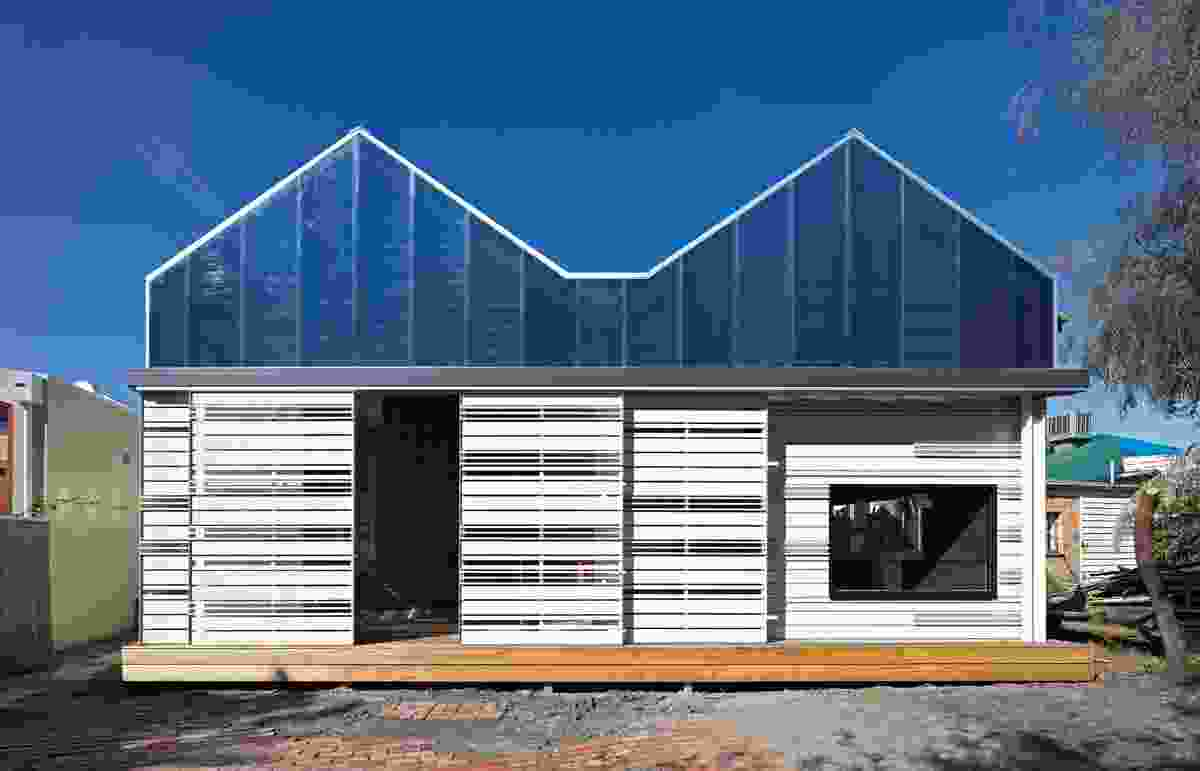 The rear elevation is an abstracted form of the existing hipped roof.