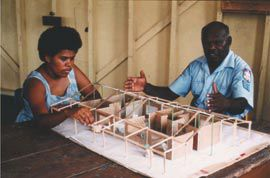 Hobson and Anna Levi with a cardboard model of their new home, Torres Strait, 1986. Photograph Paul Haar.