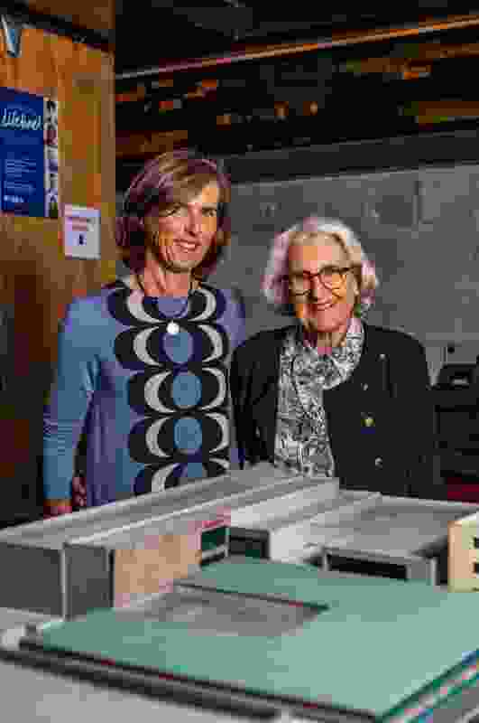 Caroline Johnston and her mother Joan Green with a model of the 1955 plan.