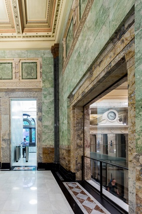Substantially restored by Tanner Kibble Denton Architects, the original banking chamber is a striking contrast to the contemporary additions above.