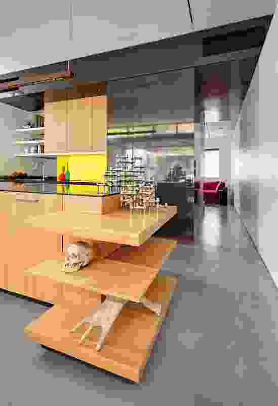 The kitchen joinery unit is designed to display the clients' varied collections of art and artefacts.
