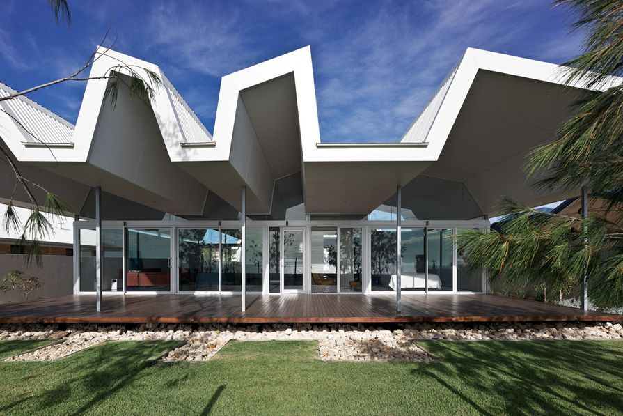 A dramatic roof form is the main feature of IPH's Florida Beach House.