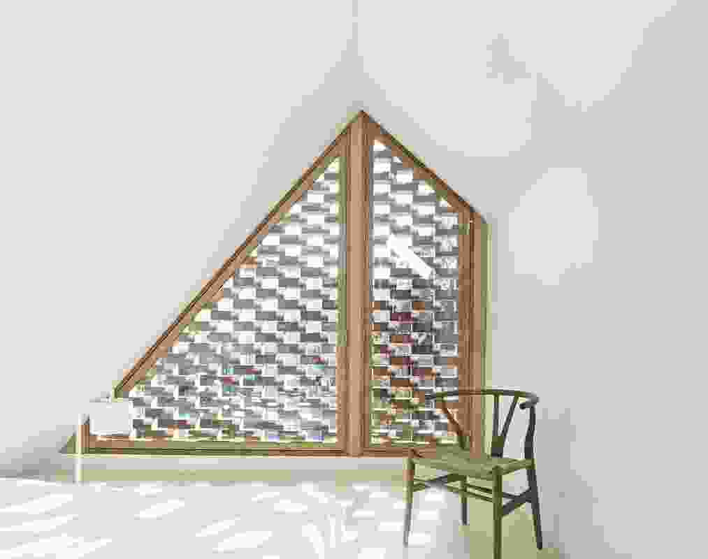 The lattice brickwork filters dappled sunlight into the mezzanine bedroom.
