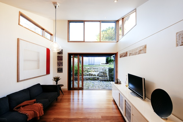 The compact living room is generously lit with clerestory windows.