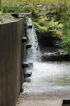 Water cascades down a concrete weir.