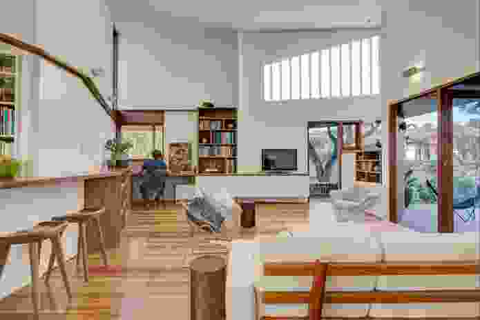 The study, library, kitchen, dining and living spaces are all housed within the dynamic primary living area, whose windows are cleverly positioned to capture sunlight.