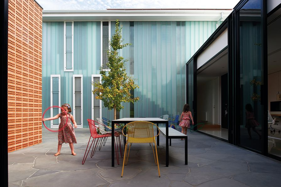 A central courtyard joins the old and new parts of the house and forms a primary activity zone for the family.