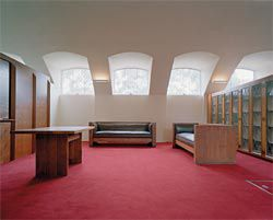 The refurbished anteroom at Newman College carefully organizes a collection of Griffin furniture, along with 1950s bookcases.