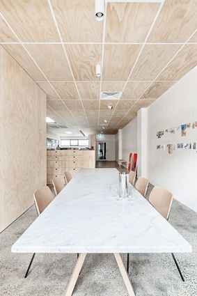 Plywood walls, ceiling and joinery surround the architecture studio's meeting space.