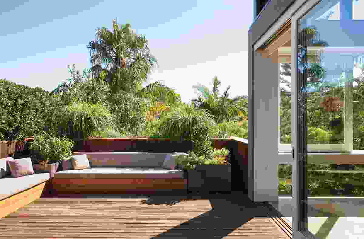 The balcony garden with outdoor lounges and planter boxes.