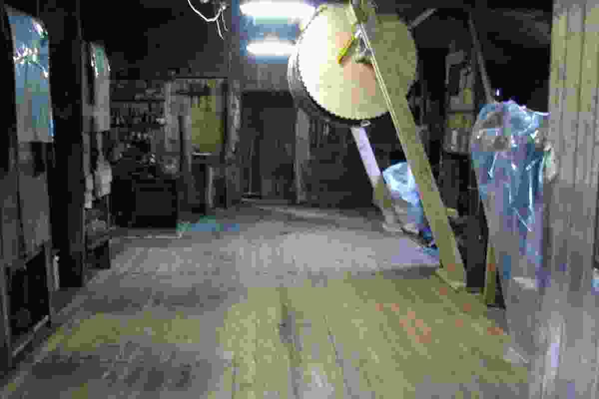 Restoration of the floor in Scott's Cape Evans Hut: The floorboards were re-laid to their original state.