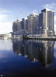 New Quay, seen across Victoria Harbour. The residential towers are by SJB/FKA Architects, the wateredge kiosks are the outcome of a design competition for RMIT students and were completed in collaboration with SJB/FKA Architects. McGauran Giannini Soon's restaurant pods are to the far left. Photograph James Widdowson.