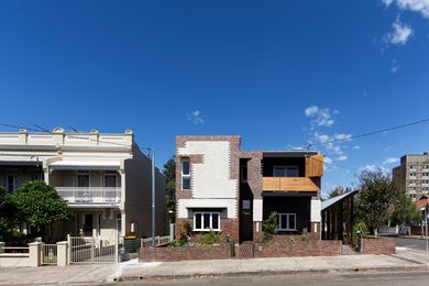 The large original house on the Marrickville site has been divided down the middle to create two dwellings with separate entries (Lots 1 and 2).